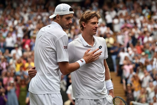 South Africa's Kevin Anderson, right, is congratulated by John Isner of the United States, right, after their men's singles semifinals match at the Wimbledon Tennis Championships, in London. (Image: Photo via AP)