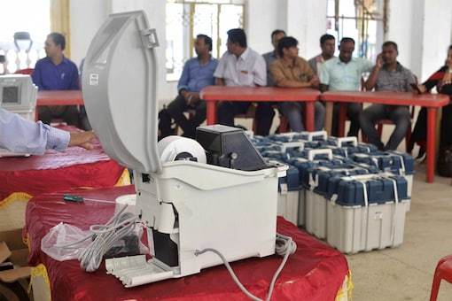 File photo of election officials checking VVPAT machines. (PTI)