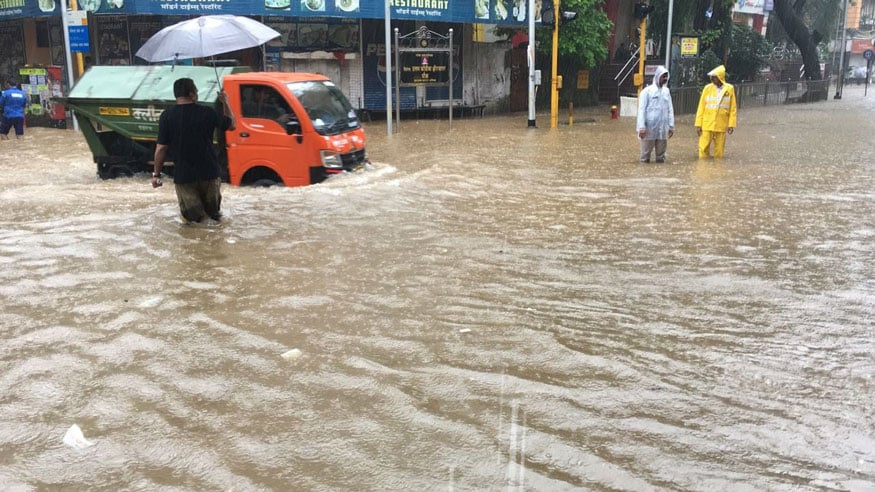 A scene from the water-logged street after the heavy downpour in Mumbai. (Image: Rajesh Saple/News18)