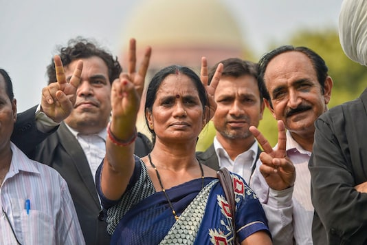 Nirbhaya's parents show victory sign after the Supreme Court's verdict. (PTI File Photo/Ravi Choudhary)