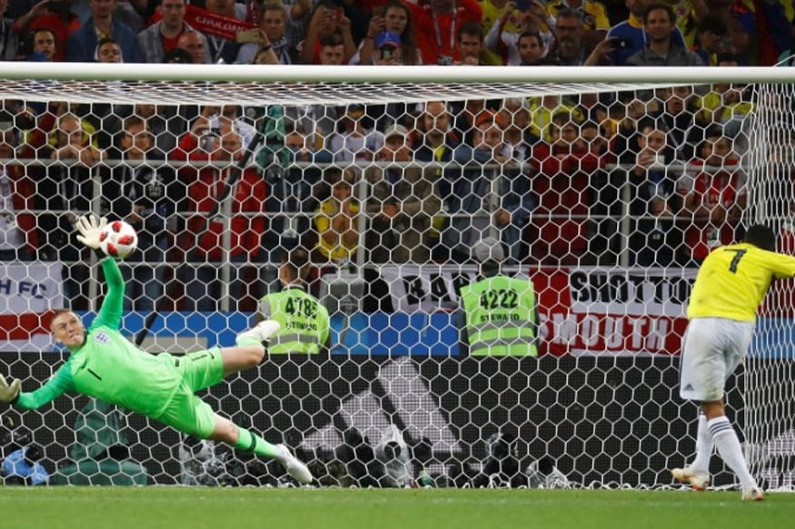 Jordan Pickford saves the penalty for England. (REUTERS)