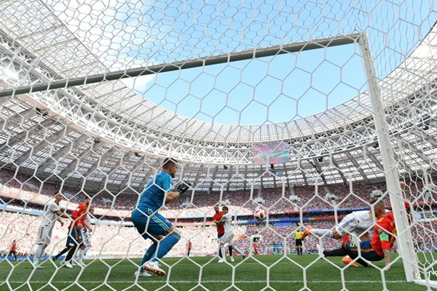 Russian Federation  beat Spain on penalties to reach World Cup quarters