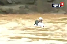 Watch: Locals Risk Their Life While Crossing A River In Valsad