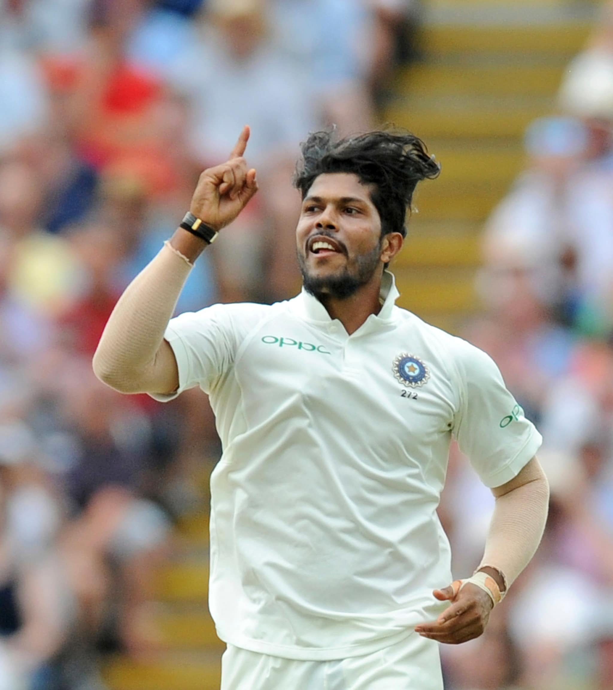 Umesh Yadav celebrates the dismissal of England's Adil Rashid during the third day of the first test cricket match between England and India at Edgbaston in Birmingham, England, Friday, Aug. 3, 2018. (AP Photo/Rui Vieira)
