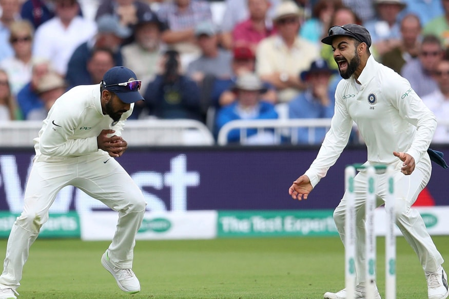 India's Lokesh Rahul, left, catches out England's Ben Stokes as teammate Virat Kohli looks on during day two of the third Test match at Trent Bridge in Nottingham. (AP)