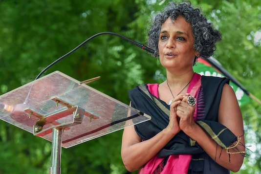 Author and activist Arundhati Roy addresses  an event at Jantar Mantar in New Delhi. (Image: PTI)
