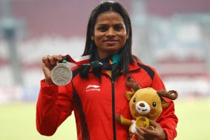 Women's 200m silver medalist India's Dutee Chand stands on the podium during the athletics competition at the 18th Asian Games in Jakarta, Indonesia. (Image: AP)