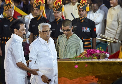 DMK general secretary K Anbazhagan with DMK working president MK Stalin pays tribute during DMK chief M Karunanidhi's funeral ceremony at Anna Memorial, in Chennai. (Image: PTI)