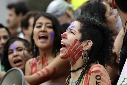 Activists and protesters shout during a demonstration against what they claimed is the expensive cost of the papal visit and also the tolerance of the Catholic church on priests who rape and commit pedophiliac acts. (Image: Reuters)