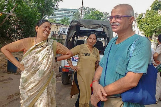 Human rights advocate Sudha Bharadwaj (L) after she was arrested by the Pune police in connection with the Bhima Koregaon violence, in Faridabad. (Image: PTI)
