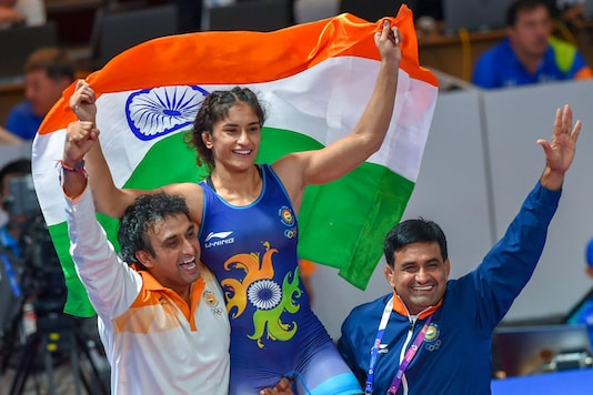 India's Vinesh Phogat celebrates with the Tricolour after winning the Gold medal in women's freestyle 50 kg wrestling at the Asian Games 2018, in Jakarta. (Image: PTI)