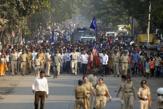 Policemen accompany Dalit groups as they staged a protest against the violence in Bhima-Koregaon area of Pune.  (Photo: PTI)