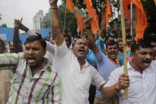 Maratha community members shout slogans during a protest in Mumbai on July 25, 2018. (AP Photo/Rafiq Maqbool)