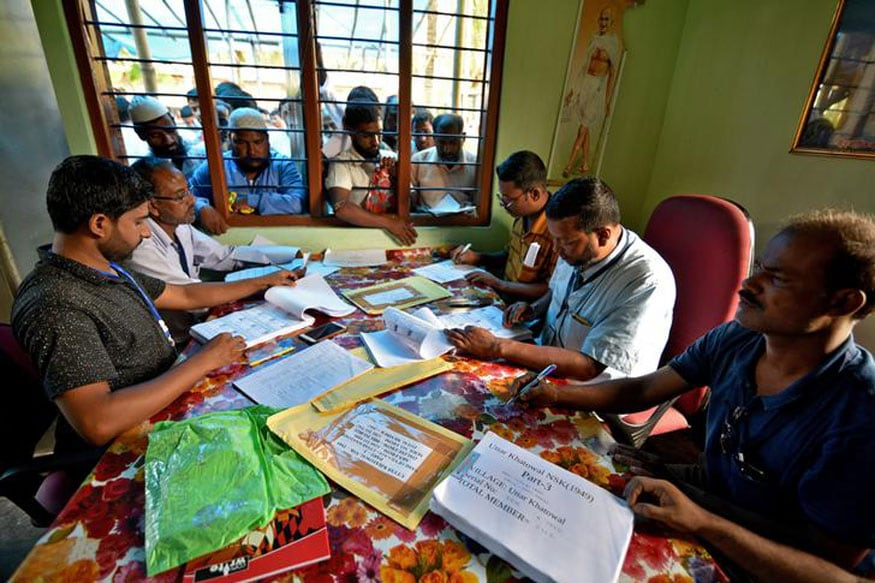 Representative image. People wait to check their names on the draft list at the National Register of Citizens (NRC) centre at a village in Nagaon district, Assam state, India, July 30. (Image: Reuters)