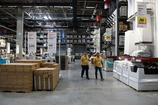 Staff walk at the warehouse area of the new IKEA store in Hyderabad. (Image: AFP)