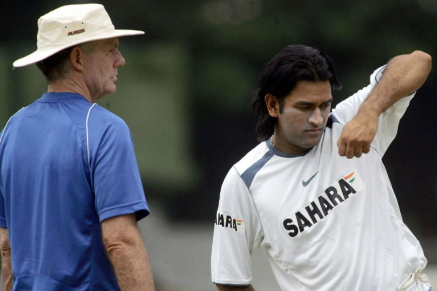 Indian cricket coach Greg Chappell (L) looks on as Mahendra Singh Dhoni practices a batting technique during a practice session at The National Cricket Academy (NCA) in Bangalore, 02 September 2006. A nine day long training camp for Indian cricketers in preparation for the forthcoming tri-series with Australia and West indies in Malaysia, is continuing in the southern Indian city. AFP PHOTO/Dibyangshu SARKAR