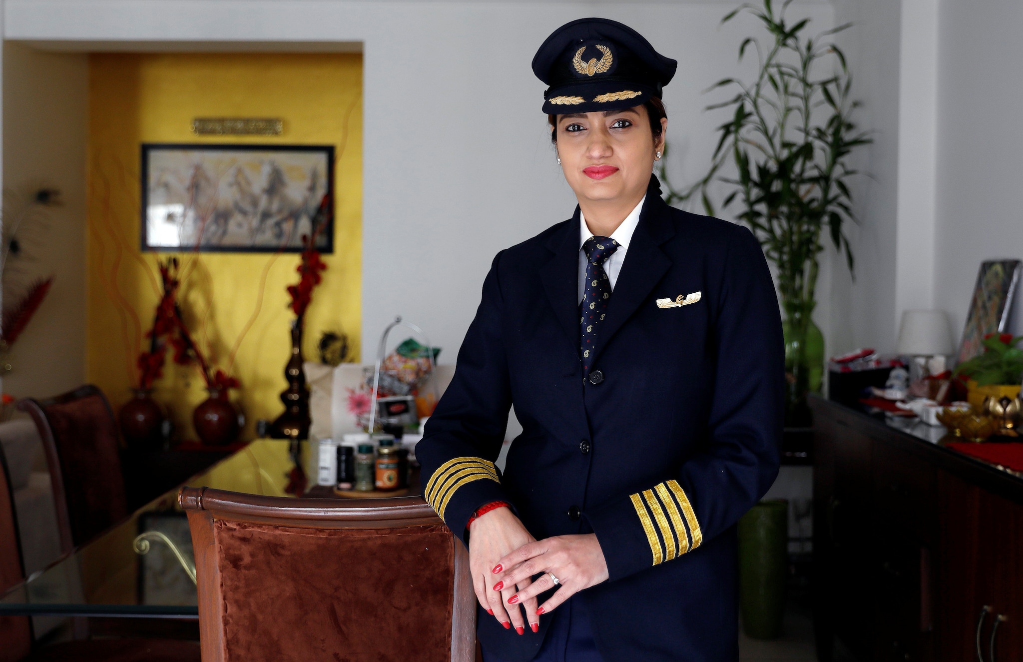 Shweta Singh, a Jet Airways pilot, poses for a picture inside her house in Gurugram, September 3, 2018. REUTERS/Adnan Abidi