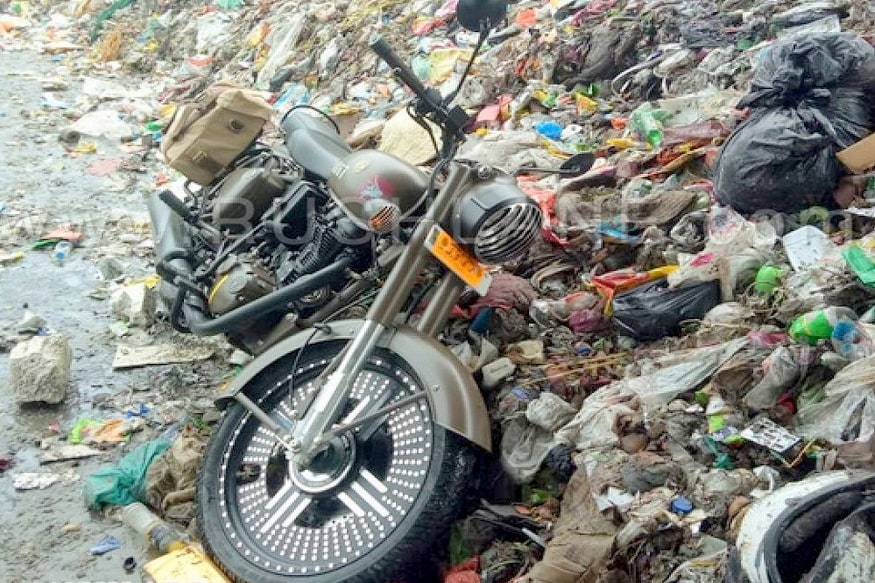 owner throws royal enfield pegasus 500 worth rs 2 4 lakh in garbage