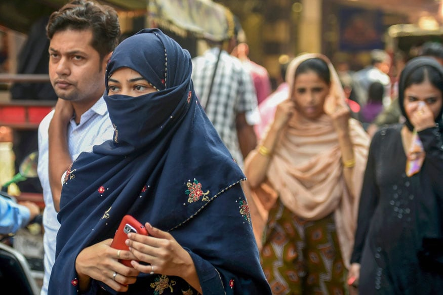 New Delhi: A Muslim woman walks in a market, near Jama Masjid in New Delhi, Wednesday, Sept 19, 2018. The Union Cabinet approved an ordinance to ban the practice of instant triple talaq. Under the proposed ordinance, giving instant triple talaq will be illegal and void and will attract a jail term of three years for the husband. (PTI Photo/Atul Yadav) (Story No. TAR20) (PTI9_19_2018_000094B)