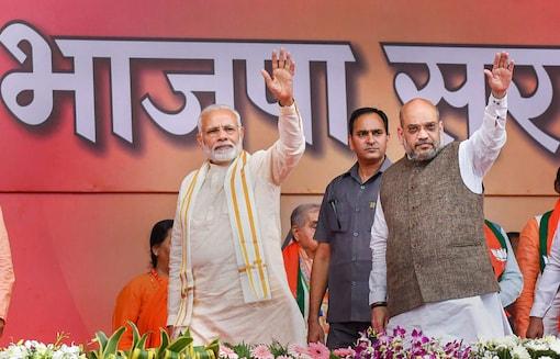 File photo of Prime Minister Narendra Modi and BJP National President Amit Shah. (Image: PTI)