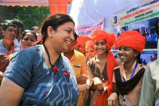 Union Textiles Minister Smriti Irani is welcomed by the students as she arrives to attend an educational event (File photo: PTI)