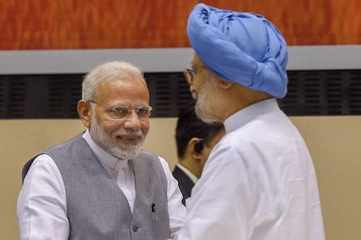 Prime Minister Narendra Modi and former prime minister Manmohan Singh during an event in New Delhi  (PTI)