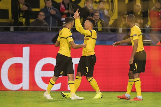 Borussia Dortmund's Jadon Sancho (centre) celebrates scoring against Atletico Madrid in the UEFA Champions League (Image: BVB/Twitter)