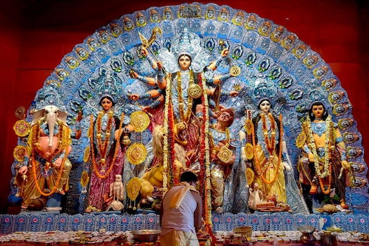 Kolkata: A priest offers Maha Ashtami