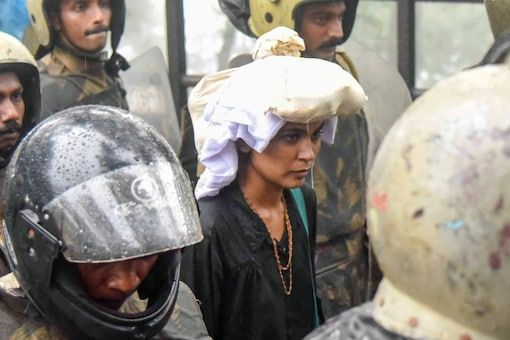 File photo of October 2018 showing activist Rehana Fathima being escorted by the police to Sabarimala Temple, Kerala. (PTI)