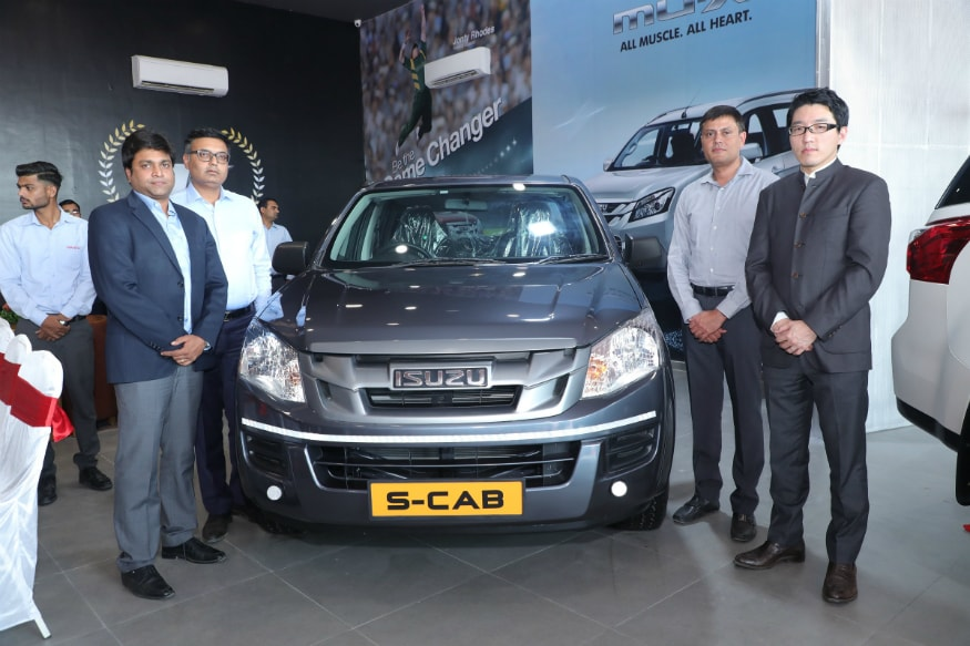 From R to L- Takeshi Hirano, VP-Sales & Marketing,Isuzu Motors India, Kuren Amin,MD-Torque and Rupen Modi,Director-Torque unveiling the vehicle. (Image: Isuzu Motors)