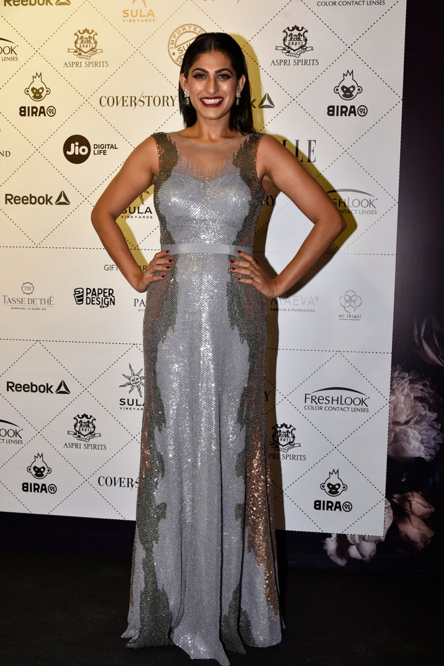 Kubra Sait smiles for a photo as she walks the red carpet at the Elle Beauty Awards 2018 in Mumbai. (Image: Viral Bhayani)