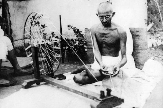 Mahatma Gandhi using a spinning Wheel in the Sabarmati Ashram. (Image: Getty Images)