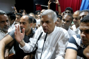 Sri Lanka's Prime Minister Ranil Wickremesinghe (C) speaks to his supporters in October after being ousted by Mathripala Sirisena. (REUTERS)