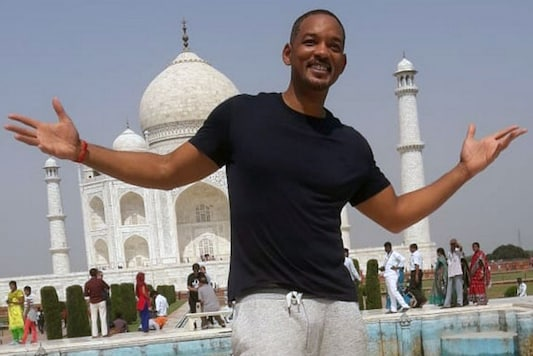 Will Smith poses for the cameras in front of Taj Mahal in Agra on Oct 10, 2018. (Image: News18)