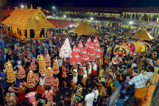 File photo of a procession by devotees at the Lord Ayyappa temple in Kerala's Sabarimala. (PTI)
