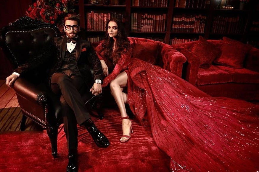 While the actress looks stunning in her red gown, Ranveer looks dapper in a black tux with round glasses.  (Image: Instagram)