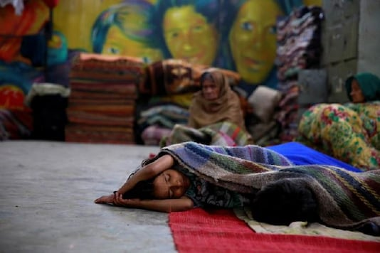 A child sleeps in a government shelter for homeless people to escape the cold in Delhi. (Representative image)