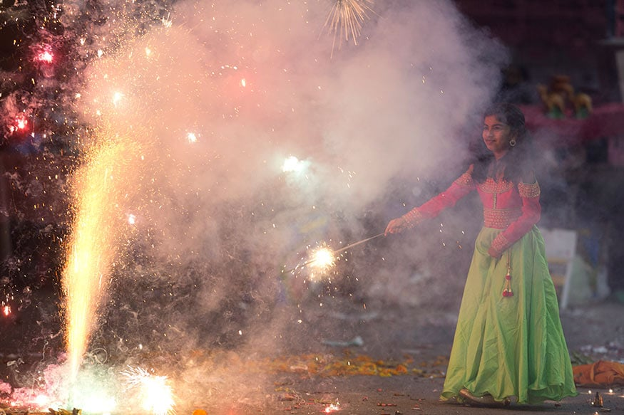 Pictures Show People Celebrating Diwali By Bursting