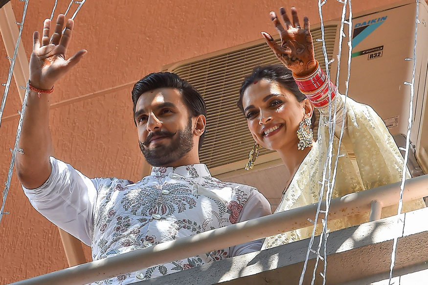 Ranveer Singh and Deepika Padukone greet fans from the balcony of their Bengaluru residence. (Image: PTI)