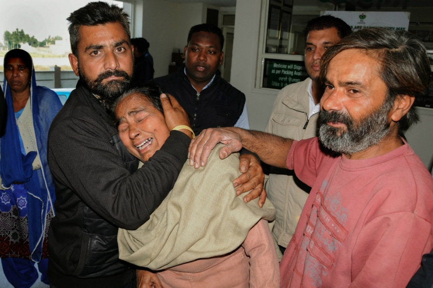 Wailing relatives of a victim after two men on a motorcycle reportedly threw a grenade at the Nirankari Bhawan during a religious congregation, in Adliwal village near Amritsar on Sunday. (PTI)