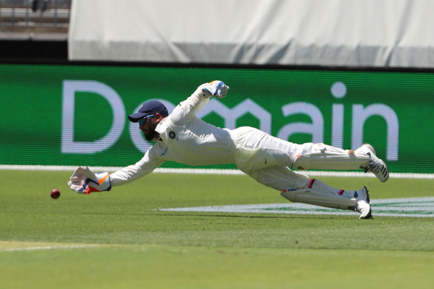 India's Rishabh Pant dives for a ball hit by Australia's Marcus Harris. (Image: AP)
