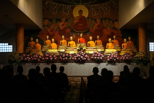 Novice monks pray during a morning routine at the Songdhammakalyani monastery in Thailand. (Image: Reuters)