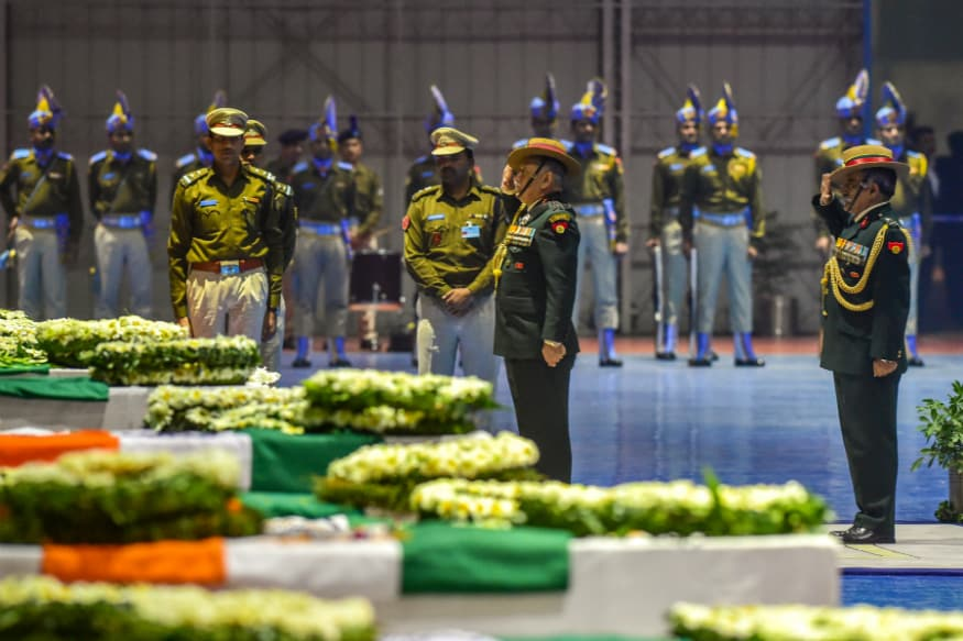 Army Chief Gen Bipin Rawat pays tribute to the martyred CRPF jawans who lost their lives in Thursday's Pulwama terror attack, after their mortal remains were brought at AFS Palam in New Delhi, February 15, 2019. (PTI Photo)