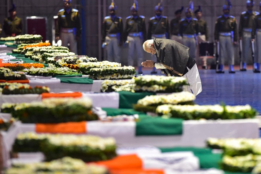 Prime Minister Narendra Modi pays tribute to the martyred CRPF jawans, who lost their lives in Thursday's Pulwama terror attack, after their mortal remains were brought at AFS Palam in New Delhi on Friday. (Image: PTI)