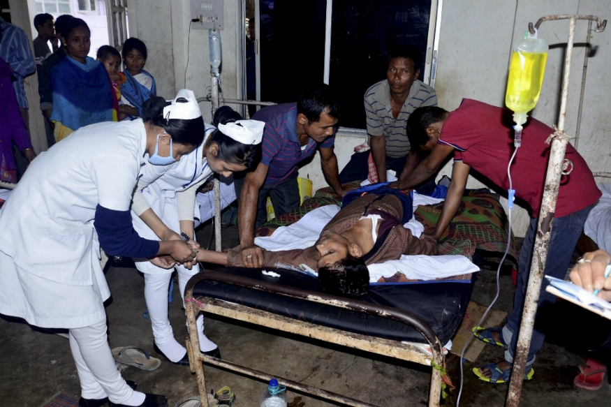 Nurses inject medicines to victims admitted into hospital after consuming spurious liquor at a tea garden, in Golaghat, Saturday, Feb 23, 2019. At least 30 people, including seven women, died allegedly after the incident. (PTI Photo)