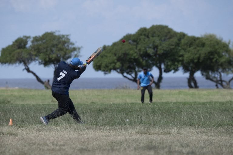An Indian living in Uruguay bats during a cricket match along Montevideo's seaside promenade. (Image: AFP)