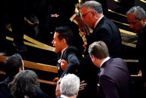 91st Academy Awards - Oscars Show - Hollywood, Los Angeles, California, U.S., February 24, 2019. Best Actor winner Rami Malek is helped up after falling down the stairs on the stage. REUTERS/Mike Blake     TPX IMAGES OF THE DAY