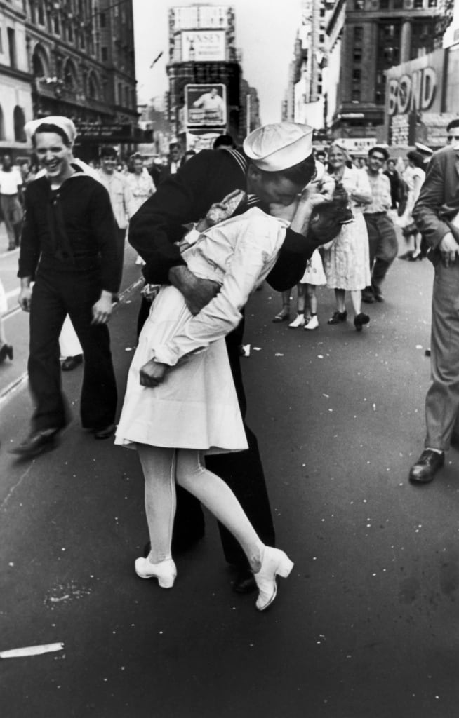 NEW YORK, UNITED STATES - AUGUST 14:  A jubilant American sailor clutching a white-uniformed nurse in a back-bending, passionate kiss as he vents his joy while thousands jam Times Square to celebrate the long awaited-victory over Japan.  (Photo by Alfred Eisenstaedt/Pix Inc./Time & Life Pictures/Getty Images)