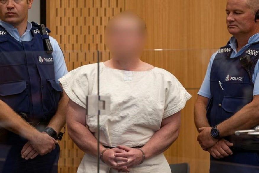 QnA VBage In Court on Charges of Murder, New Zealand Shooter Smirks, Flashes 'White Power Sign' - News18