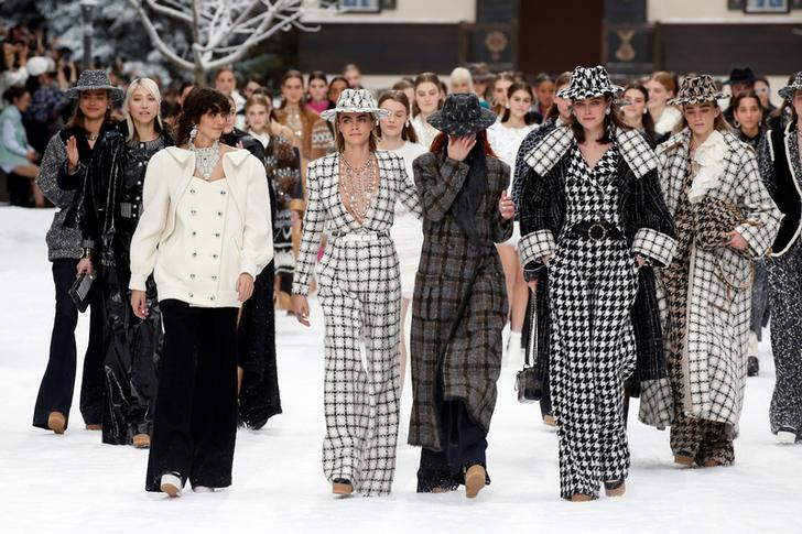 Cara Delevingne and other models react while presenting creations by late designer Karl Lagerfeld as part of his Fall/Winter 2019-2020 women's ready-to-wear collection show for fashion house Chanel at the Grand Palais during Paris Fashion Week in Paris, France March 5, 2019. REUTERS/Regis Duvignau